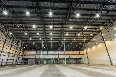 Installed commercial lighting in empty warehouse.